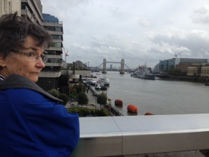 my mom stands on london bridge, across from tower bridge.